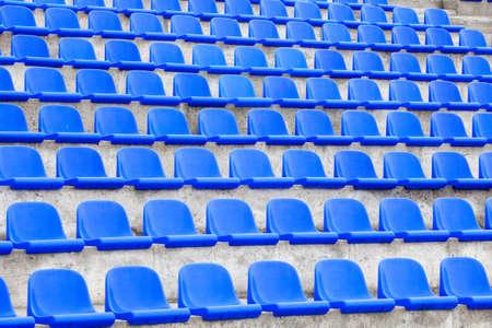 plastic blue seats on football stadium 版權商用圖片