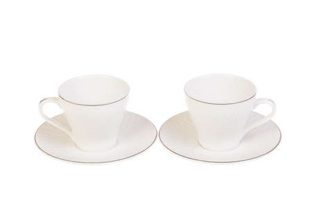 Two white porcelain tea, coffee cups with saucer. Isolated on white