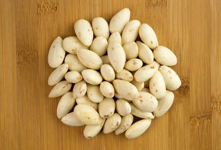 blanch: Round pile of peeled almonds after being soaked overnight