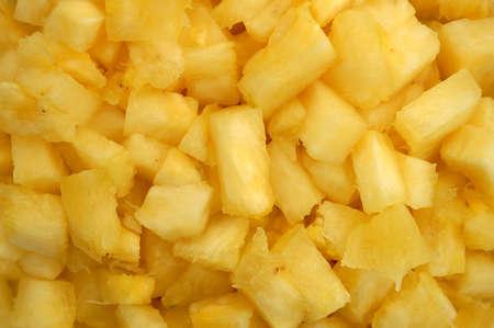 Close up macro shot of juicy chopped pineapples. Imagens - 32949364