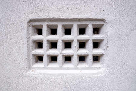 Closeup of vintage rustic old fashioned air ventilation grille photo