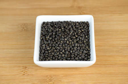 Closeup of black urad dal lentis photo
