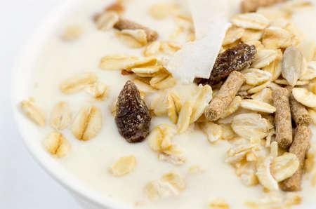 lowfat: Macro closeup of delicious low-fat yogurt with oats, muesli, bran, almonds and dehydrated fruit Stock Photo