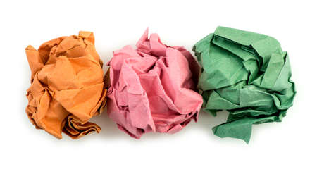 folded paper: Orange, pink and green creased folded paper balls Stock Photo