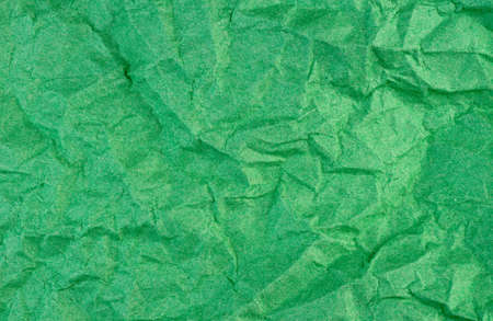 Green macro background texture of washed and weathered paper photo