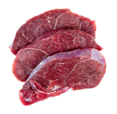 flank: Aerial of raw red meat steaks isolated against a white background