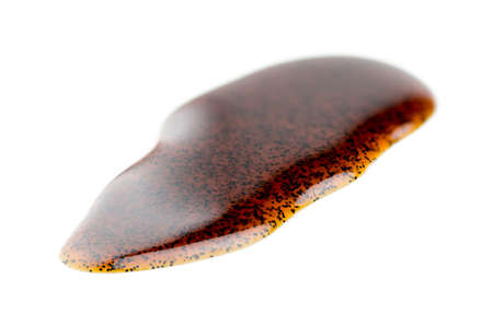 christmas paste: Macro closeup of natural real vanilla extract isolated on white