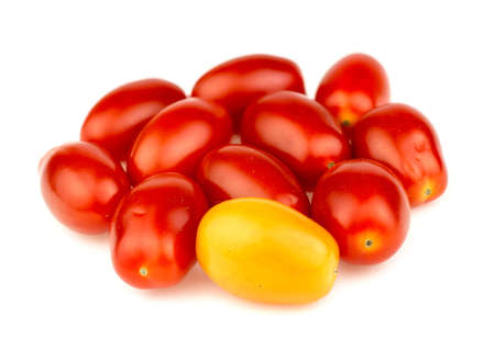outcast: Group of ripe red and gold grape tomatoes isolated against white