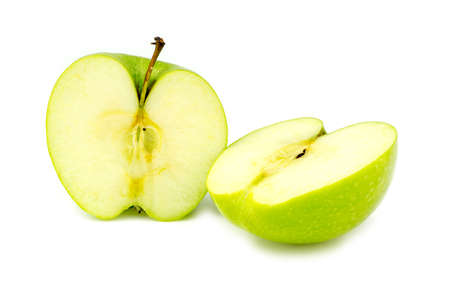 granny smith apple: Chopped halves of fresh organic green granny smith apple Stock Photo