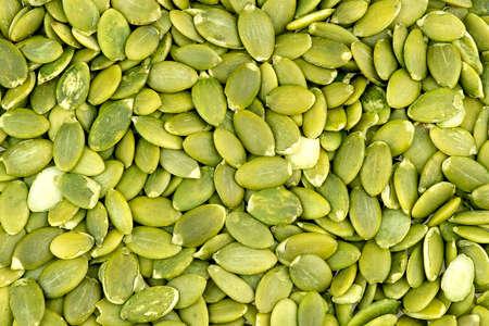 Macro background texture of green pumpkin seeds