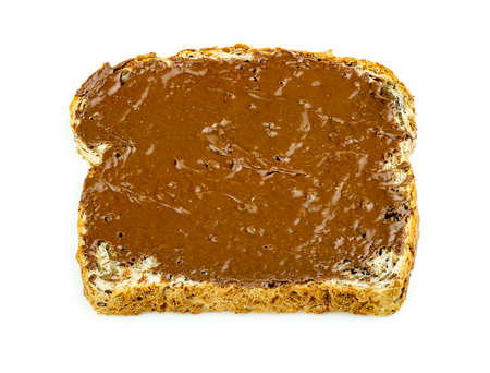wheat toast: Chocolate hazelnut spread on whole wheat toast isolated Stock Photo