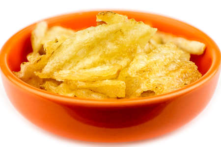 thick: Thick rippled potato chips in bowl isolated Stock Photo