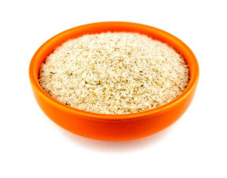 purgative: Healthy psyllium husks in bowl on white