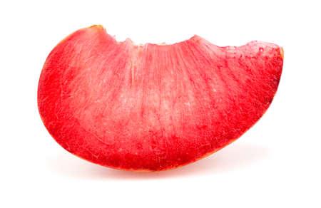 Colorful bright macro closeup slice of pluot apricot plum fruit studio Imagens - 36183877