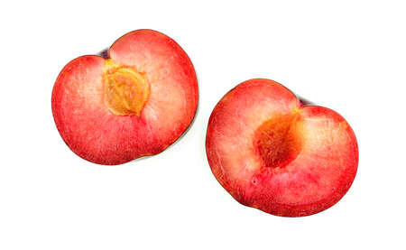 insides: Plum cut in half, vibrant juicy insides Stock Photo