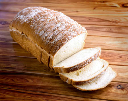 Loaf of bread on wooden background photo