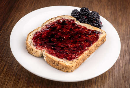 wheat toast: Blackberries with blackberry jam on whole wheat toast