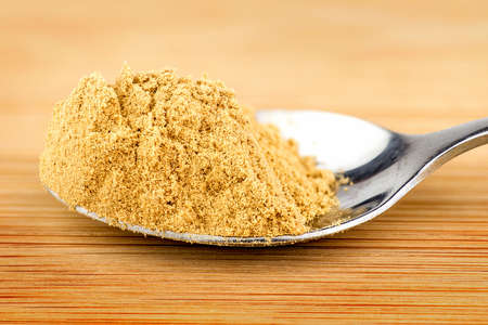 spoonful: Spoonful of ground ginger powder