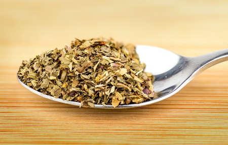 spoonful: Macro of spoonful of dried oregano herb
