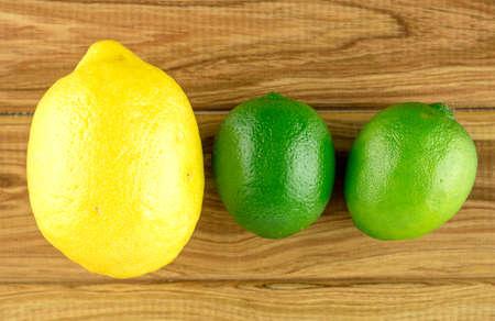 rustic  wood: Lemon and limes on rustic wood