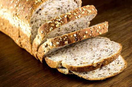 multi grain sandwich: Macro closeup of rustic slices whole wheat multi grain bread on wooden background