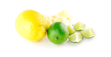 cut up: Whole and cut up organic fresh lemons and limes Stock Photo