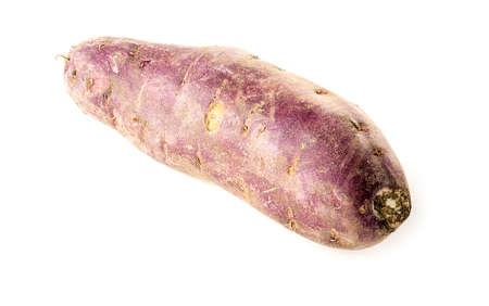 Raw unpeeled purple sweet potatoe