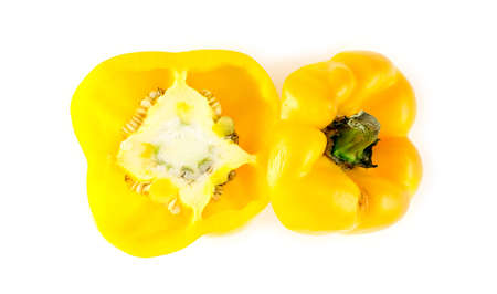Inside of yellow bell pepper capsicum with seeds and top stem cut off