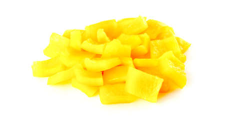 Macro of diced yellow pepper on white