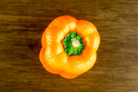 crinkled: Top view of orange bell pepper with crinkled skin