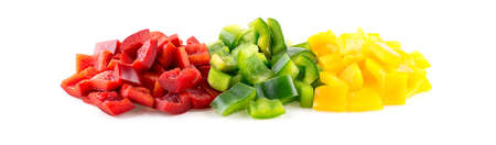 pimiento: Vibrant red, green and yellow capsicum peppers cut into pieces on white