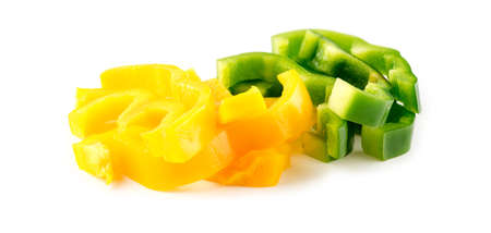 Macro of yellow and green bell peppers chopped into strips