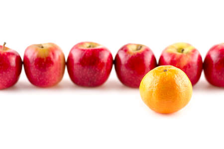 'odd one out': Single orange infront of line of apples