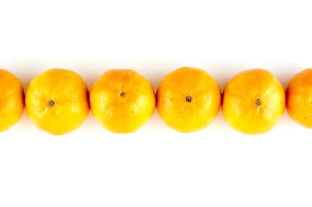 Line of oranges isolated on white with copyspace