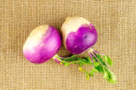 rutabaga: Spherical shaped turnips with green leafy stalks Stock Photo