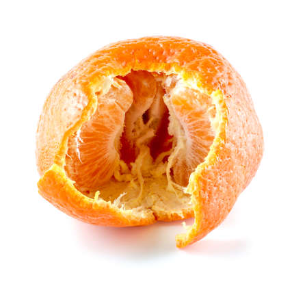 Torn mandarin showing inside with segments of citrus