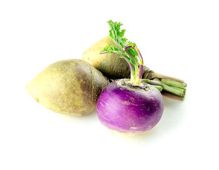 Purple turnip and two swedish turnips on white