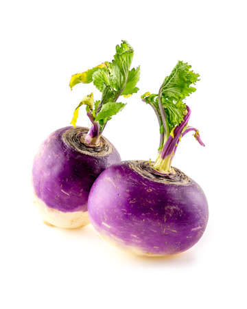 Two purple turnips with leafy tops isolated on white Imagens