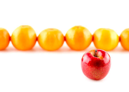 'odd one out': Red apple infront of oranges, odd one out