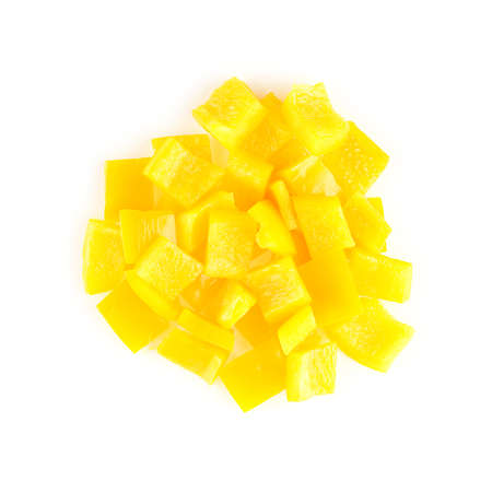 Circular pile of chopped yellow capsicum on white background Imagens