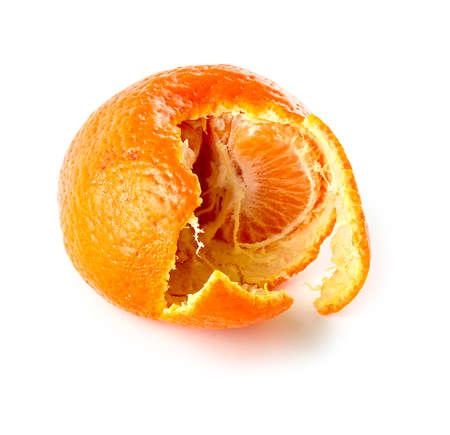Mandarin orange with semi peeled skin showing segments of juicy fruit inside Imagens