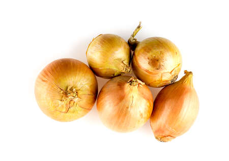 Golden orange colored onions isolated on white