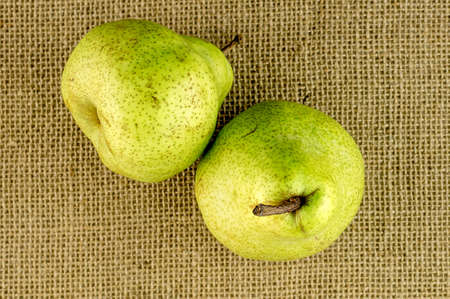 hessian: Ripe crispy green pears against hessian beckground