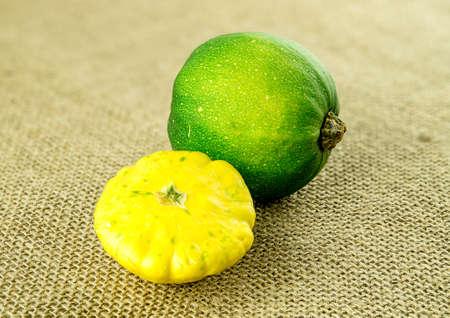 Bright yellow button squash and green gem pumkin
