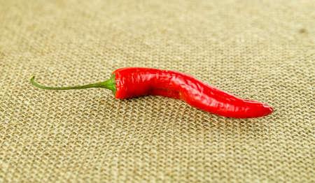 Aromatic chili against hessian texture
