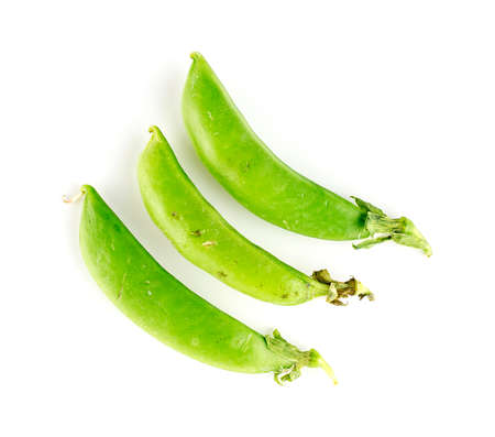 Three pods of sugar snap legumes on white Imagens