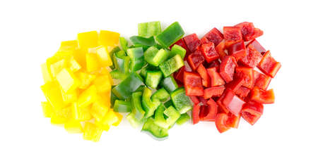 Aerial view of tasty raw yellow green and red bell peppers against white background