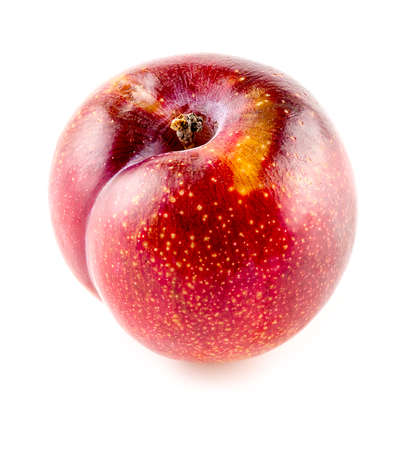 ripened: Closeup of over ripened yellowing plum on white background