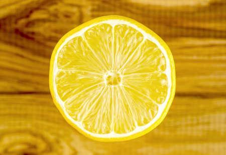 pulp: Shiny circular lemon cut with shiny inside pulp