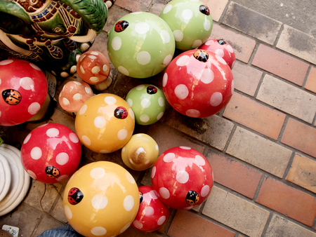 decorate: colorful stucco mushrooms in garden for decorate